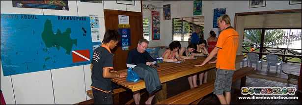James overseeing an exam in the Gaya Island Beach House  a.k.a. our Paradise Classroom